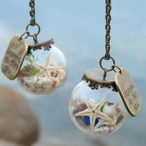 Dreaming of the sea globe vintage necklace